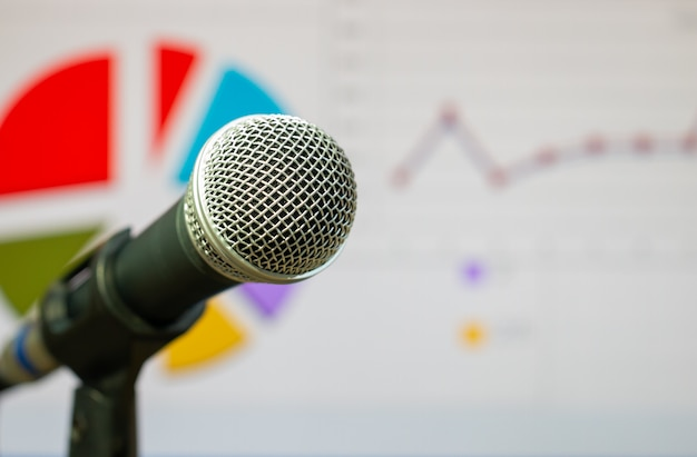 Microphones on voice speaker in cooperate or university lecture hall