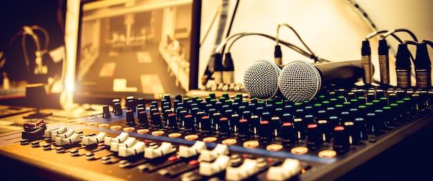Microphones with sound mixer in studio.