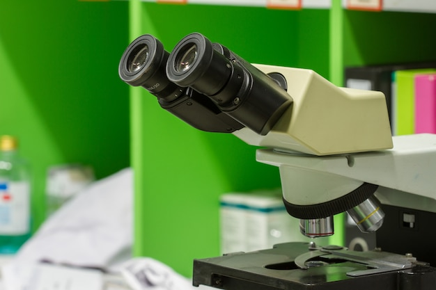 Microscopes in laboratory hospital,   medicine equipment and health concept, selective focus