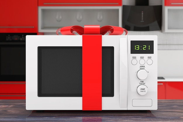 Microwave oven gift with red ribbon and bow on a wooden table . 3d rendering