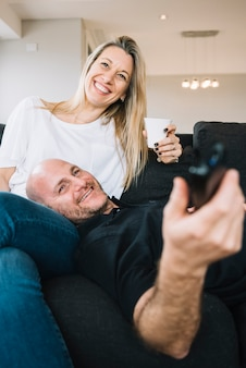 Mid aged couple in love at home
