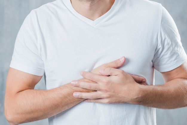 Mid section of a man having chest pain