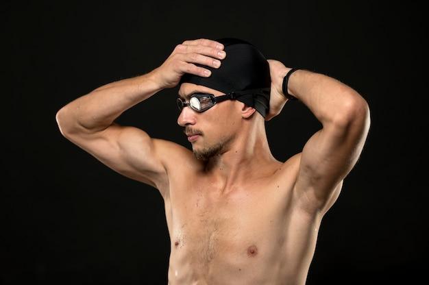 Mid shot athlete fixing cap