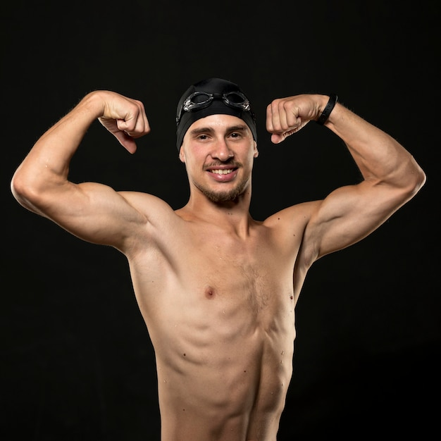 Mid shot athlete flexing muscles
