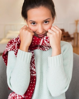 Mid shot cozy woman with scarf