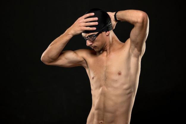 Mid shot swimmer fixing cap