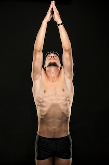 Mid shot swimmer stretching arms