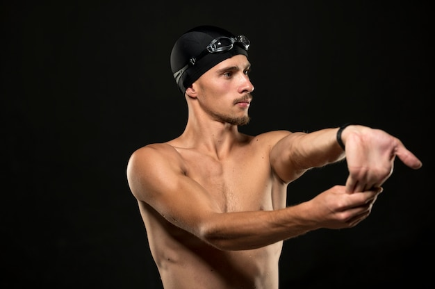 Mid shot swimmer stretching fingers