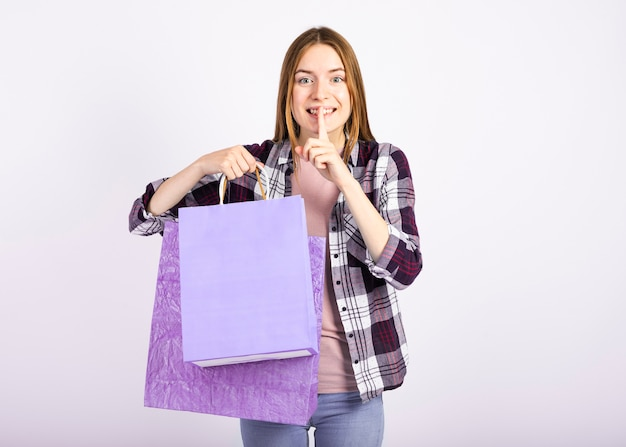 Mid shot of a woman holding bags