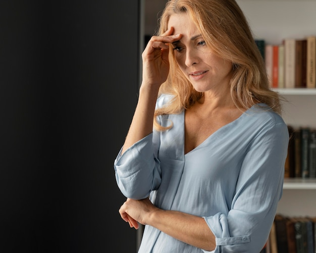 Mid shot worried woman counselor in office