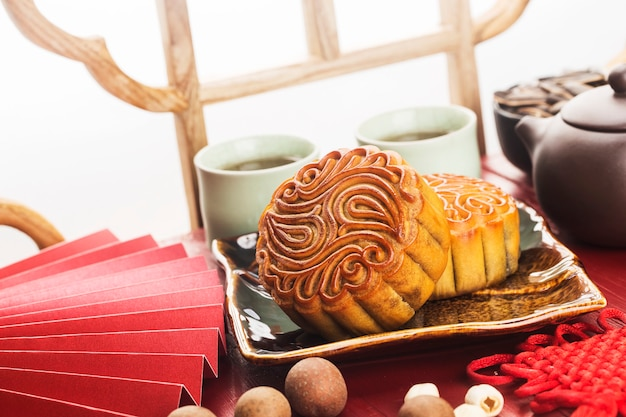 Midautumn festival concept traditional mooncakes on table  with teacup
