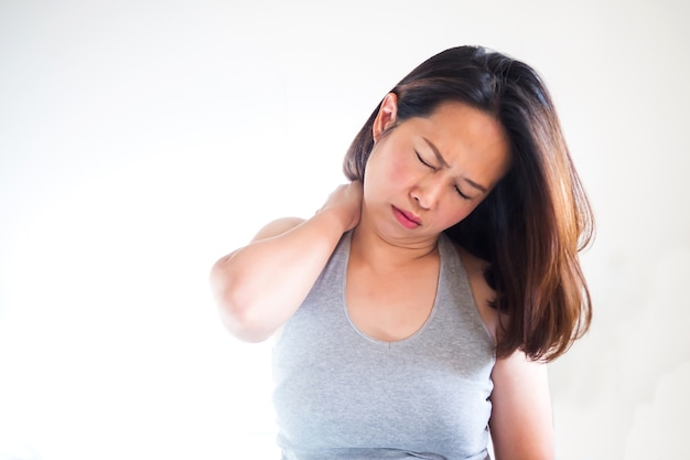 Middle adult asian woman use hand massaging shoulder