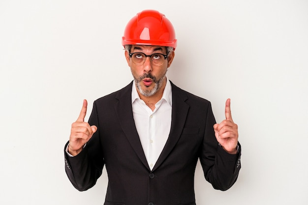 Middle age architect caucasian man isolated on white background  pointing upside with opened mouth.