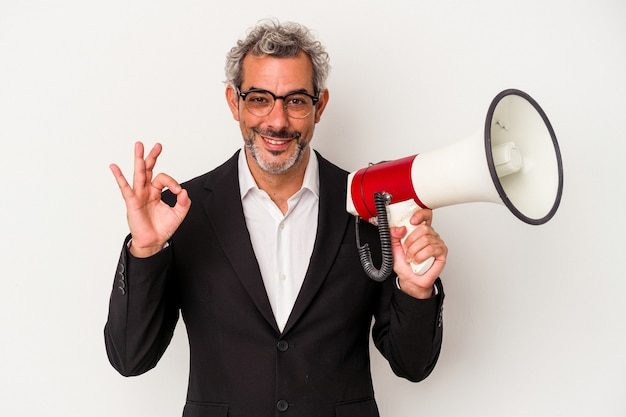 Middle age business man holding a megaphone isolated on white background  cheerful and confident showing ok gesture.