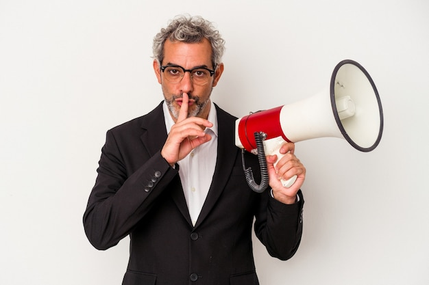 Middle age business man holding a megaphone isolated on white background  keeping a secret or asking for silence.
