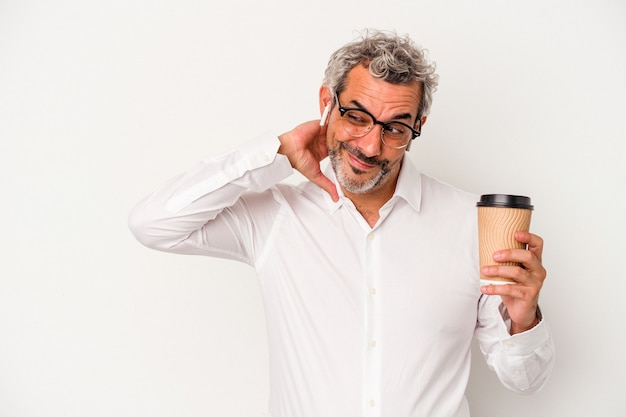 Middle age business man holding a take away coffee isolated on white background  touching back of head, thinking and making a choice.