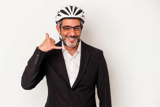 Middle age business man wearing a bike helmet isolated on blue background  showing a mobile phone call gesture with fingers.