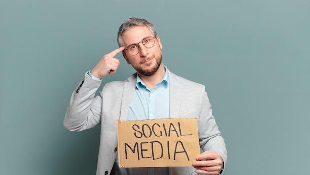 Middle age businessman. social media concept