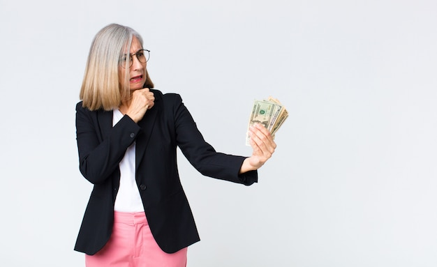 Middle age businesswoman with dollar bills