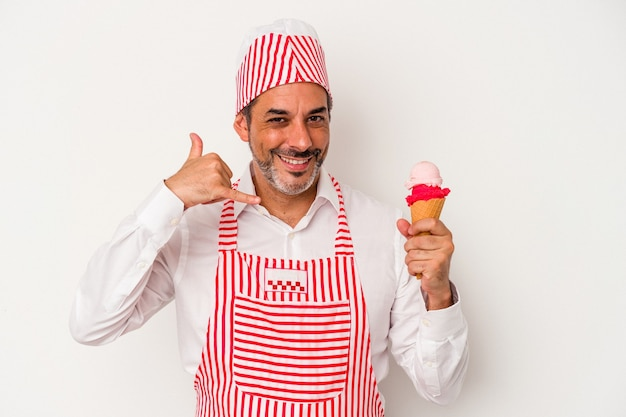 Middle age caucasian ice maker caucasian man holding an ice cream isolated on white background  showing a mobile phone call gesture with fingers.