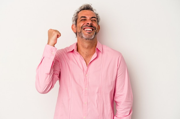Middle age caucasian man isolated on white background  celebrating a victory, passion and enthusiasm, happy expression.