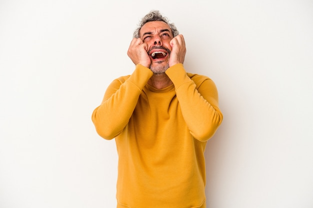 Middle age caucasian man isolated on white background  crying, unhappy with something, agony and confusion concept.