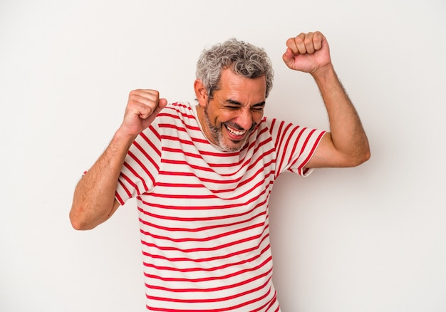 Middle age caucasian man isolated on white background  dancing and having fun.