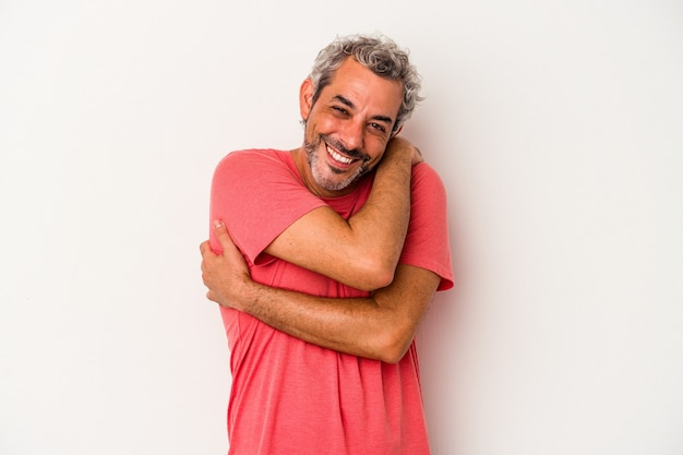 Middle age caucasian man isolated on white background  hugs, smiling carefree and happy.