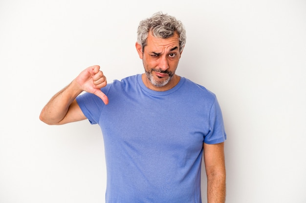 Middle age caucasian man isolated on white background  showing thumb down, disappointment concept.