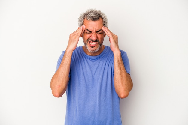 Middle age caucasian man isolated on white background  touching temples and having headache.
