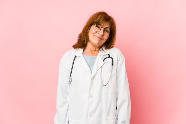 Middle age doctor woman isolated dreaming of achieving goals and purposes