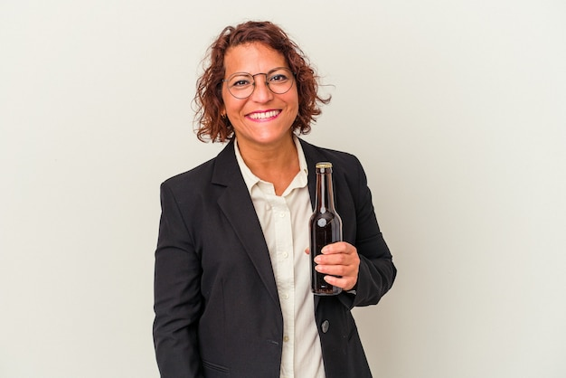 Middle age latin business woman holding a beer isolated on white background happy, smiling and cheerful.