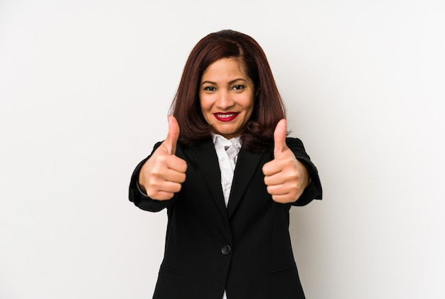 Middle age latin business woman isolated with thumbs ups, cheers about something, support and respect concept.