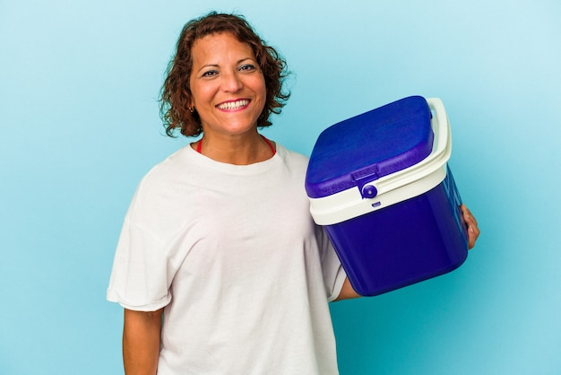 Middle age latin woman isolated on blue background happy, smiling and cheerful.