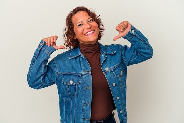 Middle age latin woman isolated on white background feels proud and self confident, example to follow.