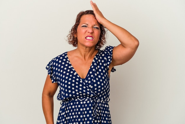 Middle age latin woman isolated on white background forgetting something, slapping forehead with palm and closing eyes.