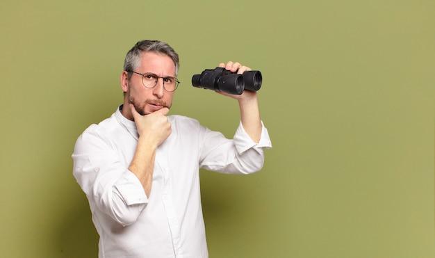Middle age man holding binoculars