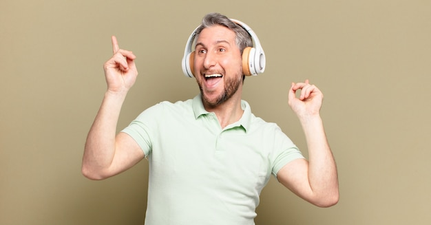 Middle age man listening music with his headphones
