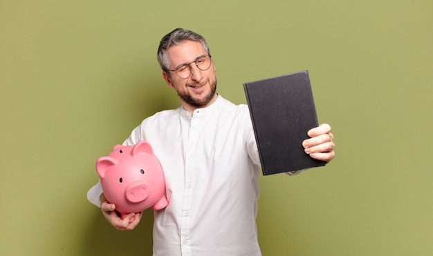 Middle age man with a piggy bank