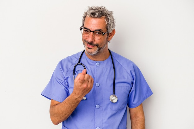 Middle age nurse caucasian man isolated on white background  pointing with finger at you as if inviting come closer.