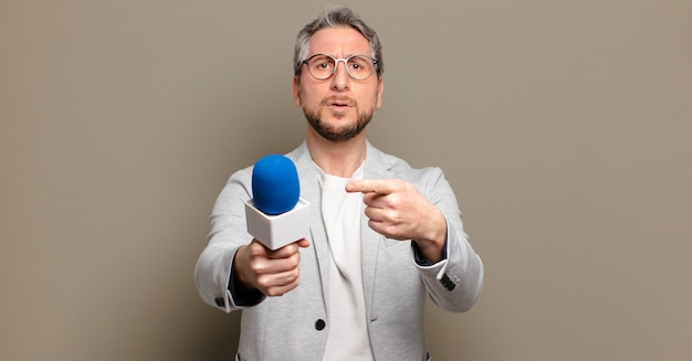 Middle age presenter man
