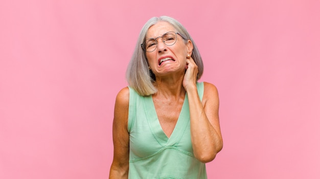 Middle age pretty woman feeling stressed and frustrated