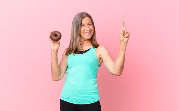 Middle age pretty woman with a donut