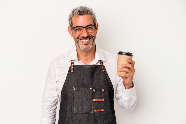 Middle age store clerk holding a take away coffee isolated on white background  happy, smiling and cheerful.