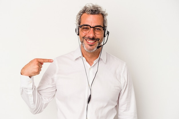 Middle age telemarketer caucasian man isolated on white background  person pointing by hand to a shirt copy space, proud and confident
