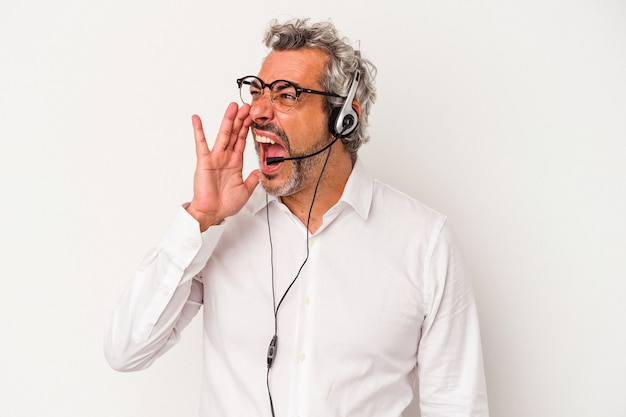Middle age telemarketer caucasian man isolated on white background  shouting and holding palm near opened mouth.