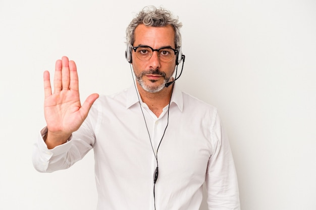 Middle age telemarketer caucasian man isolated on white background  standing with outstretched hand showing stop sign, preventing you.