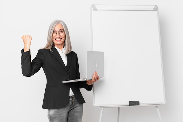 Middle age white hair businesswoman with an empty board copy space.