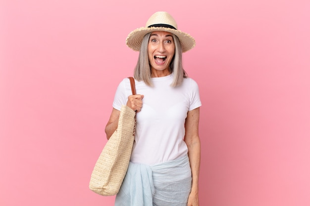 Middle age white hair woman looking very shocked or surprised. summer concept