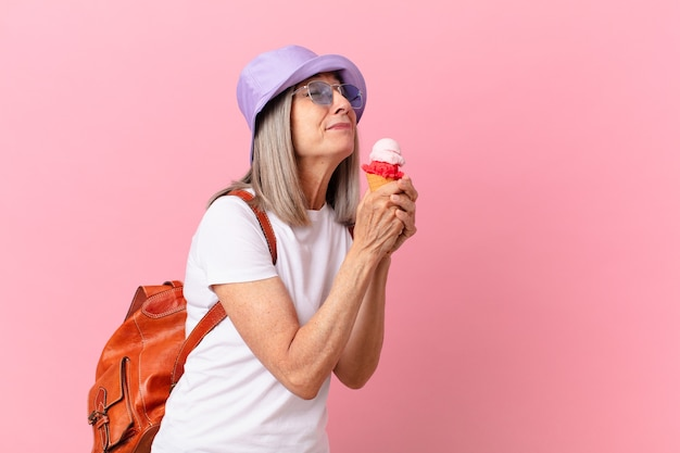 Middle age white hair woman with an ice cream. summer concept